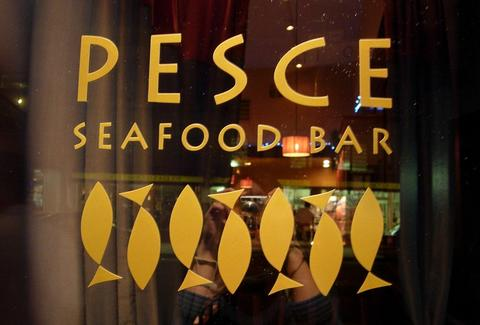 The sign on the door at Pesce