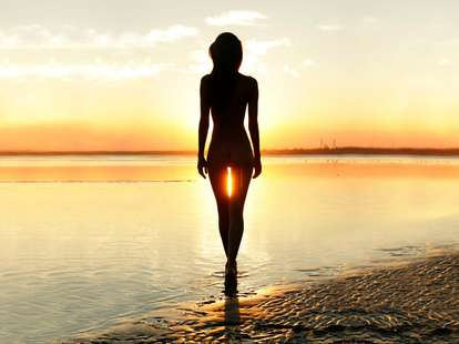 naked woman in the sunset
