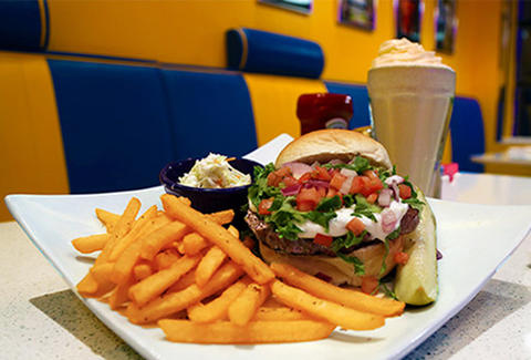 A stuffed cheeseburger and chocolate milkshake and fries from Mugshot Diner in Kensington