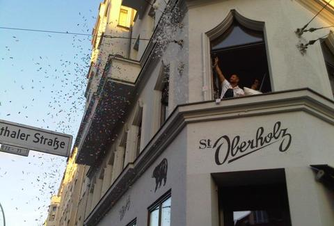 St. Oberholz sign and window, plus confetti