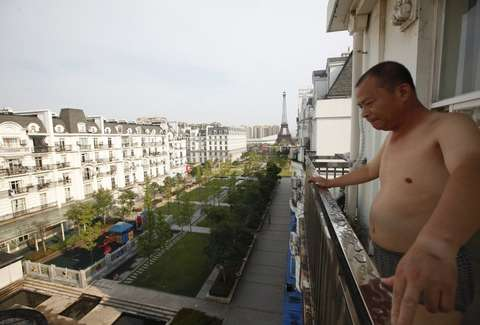 Chinese man on balcony overlooking Tianducheng