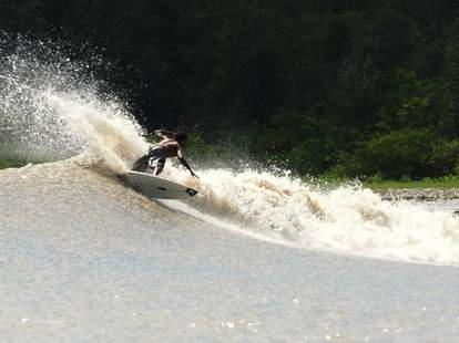 River surfing the Pororoca Bore on the Amazon River.