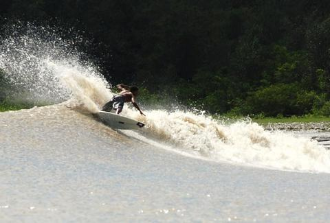 River surfing the Pororoca Bore on the Amazon River.