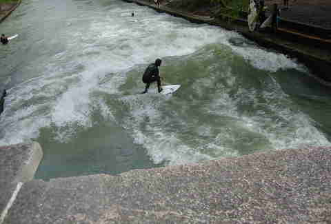 River surfing the Eisbach River in Munich Germany.