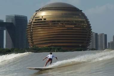 River surfing the Qiantang River in Hangzhou, China.