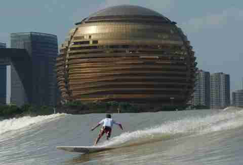 River surfing the Qiantang River in Hangzhou, China.