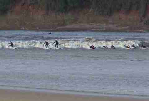 River surfing the Severn Bore near Gloucester, England.
