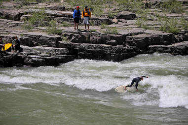 River surfing the Snake River in Wyoming