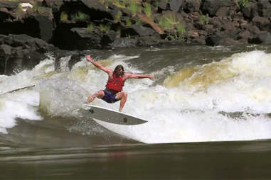 River surfing the No. 11 rapid of the Zambezi River in Zambia.