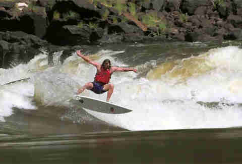River surfing the No. 11 rapid of the Zambezi River in Zambia.