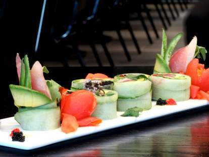 Sushi rolls wrapped in avocado with fresh ginger.
