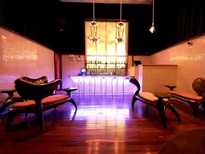 The bar at Bon San Karaoke with neon lights.