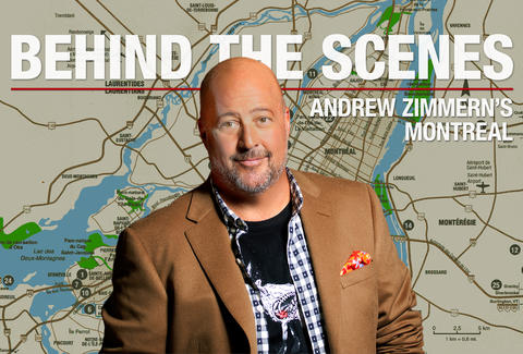 Andrew Zimmern in front of a map