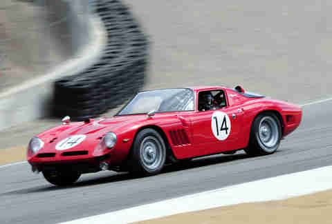 A 1968 Bizzarrini 5300 GT Strada exits the Corkscrew