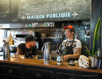 Derek Dammann, left, at work at Maison Publique in Montréal