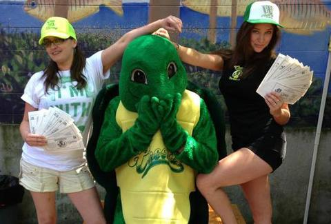 Cheerful Bullpen mascot with ladies