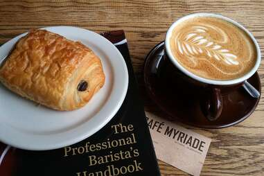 Cafe Myriade coffee, pastry, magazine and business card