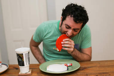 eating a Taco Bell Doritos Loco Taco