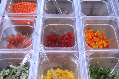 Tubs of toppings inside the Schmear It truck