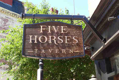 The sign at Five Horses Tavern South End