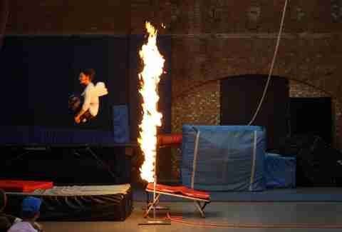 Jumping through a ring of fire at Circus Space in London, England.