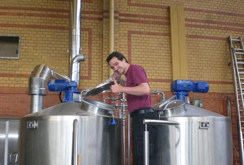 Staffer at BrewBaker with brew tanks