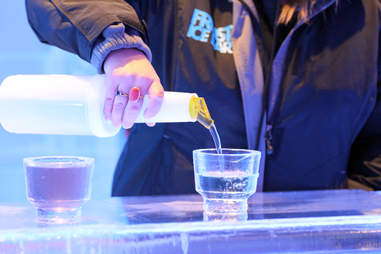 Bartender pouring drink at Frost Ice Bar