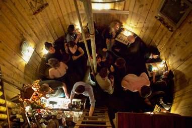 people drinking in a watertower speakeasy