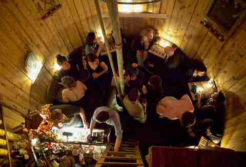 people drinking in a watertower speakeasy
