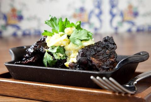 small plate charred pig at the purple pig in chicago thrillist