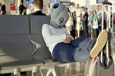 The Ostrich Pillow travel pillow.