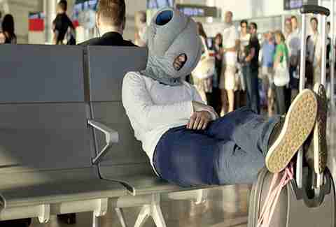 The Ostrich Pillow travel pillow.