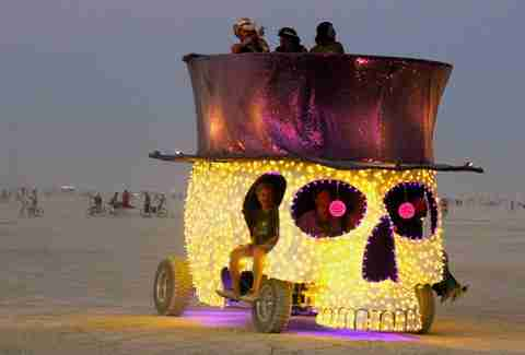 guys riding in style at burning man