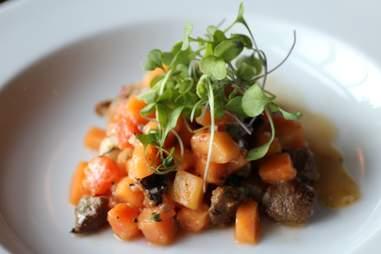The sausage and papaya salad at The Torpedo Room in Eat Street Social in Minneapolis, Minnesota.