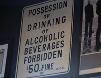 "Sign reading ""Possession or drinking of alcoholic beverages forbidden $50 fine"""