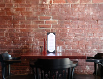 Small table by a brick wall