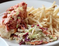 Lobster sandwich with coleslaw and fries