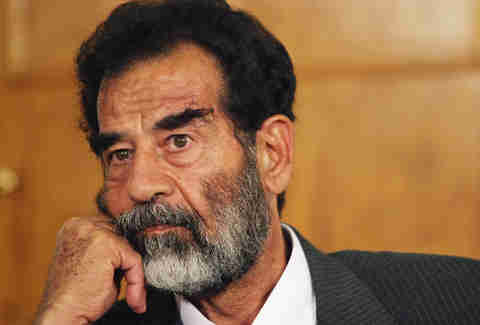 Saddam Hussein looking sad