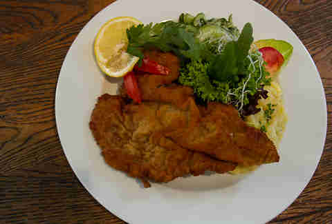 Schnitzel dish and greens