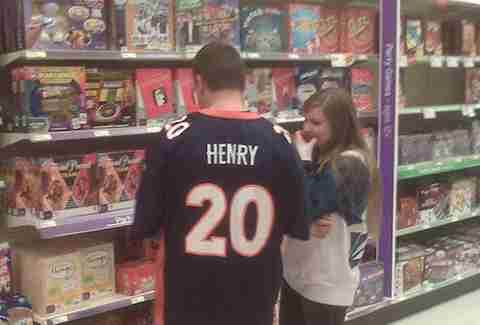 guy wearing a Travis Henry Broncos jersey