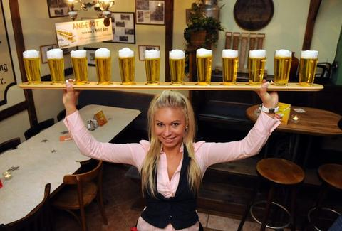 Woman holding many beers