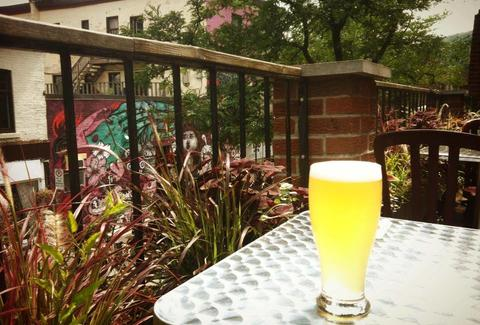 A beer on an outdoor patio table