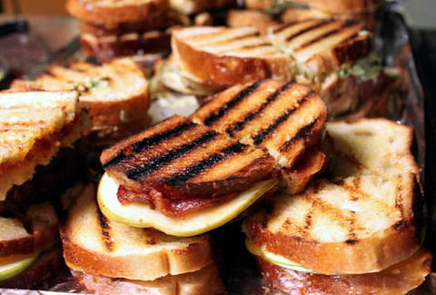 A pile of grilled sandwiches