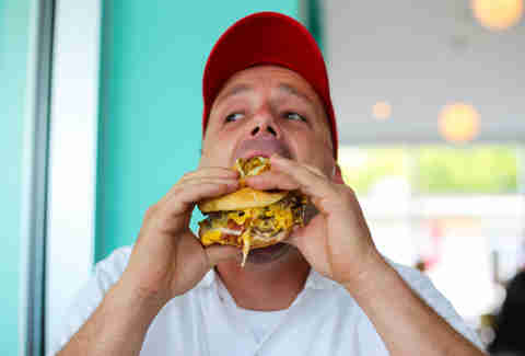 Jason from P Terry's eating a burger