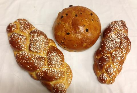 Three bread/pretzel loaves