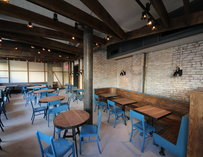 Wooden tables and bright blue chairs