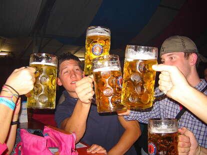 people celebrating with German beer