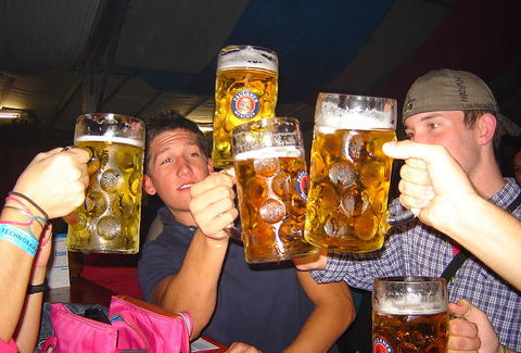people celebrating with German beer