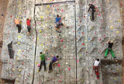 People climbing on a rock wall