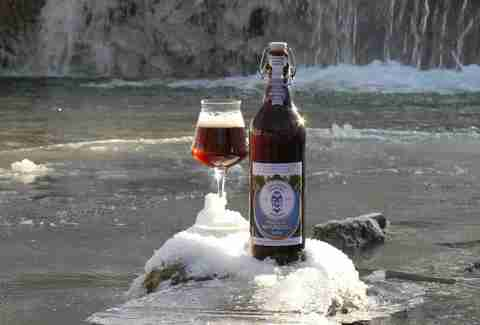 A beer by a frozen stream